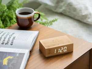 A clever natural wood alarm clock in Bamboo, which you turn over to activate alarm facility