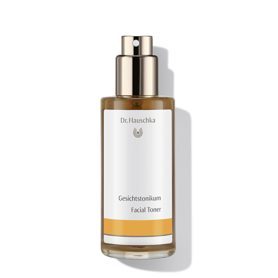 Dr Haushka glass bottle of facial toner, with gold plastic pump