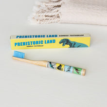 Load image into Gallery viewer, Prehistoric land bamboo toothbrush
