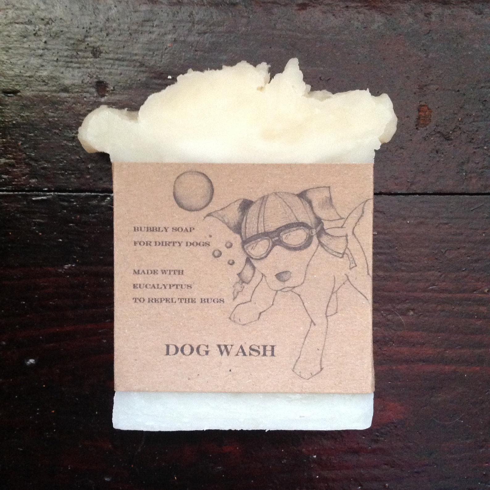 White handmade soap with brown paper packaging , dog pic in goggles.
