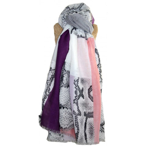 Soft, lightweight scarf featuring on-trend snakeskin print with bold blocks of colour.  100% viscose