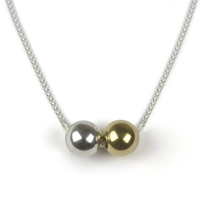 Silver necklace with 2 spheres one silver one gold colour