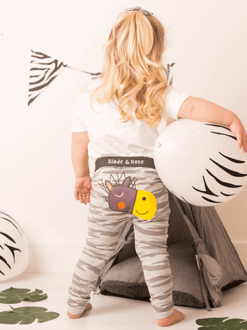 Grey striped leggings with a zebra face on the bottom