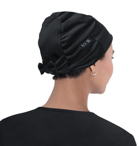 koi surgical hats and scrub caps shown in black.