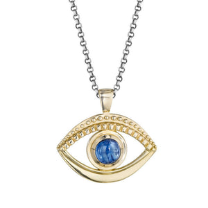 Evil eye pendant necklace in 14k gold with a blue kyanite by Jane Bartel Jewelery