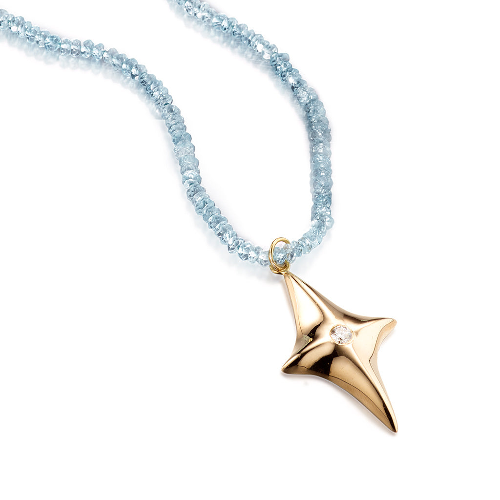 14k Gold North Star Pendant with White Diamond on a Strand of Blue Topaz Beads