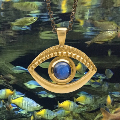 Gold evil eye pendant necklace with blue kyanite gemstone