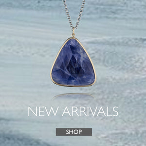 New Arrivals Collection by Jane Bartel Jewelry. Organic blue sapphire pendant necklace in 14k gold.