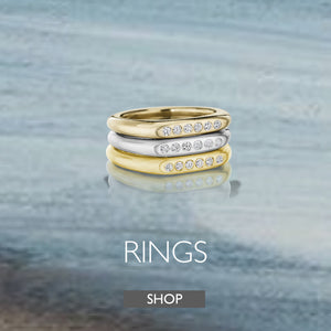 Gold stacking rings with white diamonds by Jane Bartel Jewelry. Ring collection by Jane Bartel Jewelry