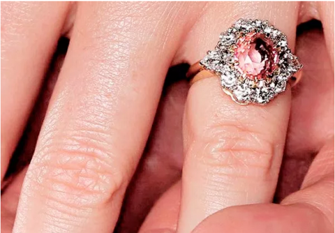 Princess Eugenie's engagement ring with a padparadscha sapphire center stone