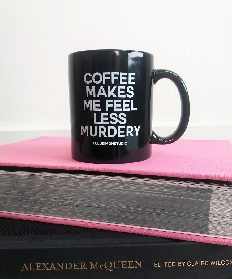 Shop our moody drinkware. Image displays our popular COFFEE MAKES ME FEEL LESS MURDERY MUG.