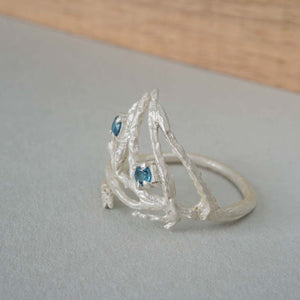 Cedar leaf ring with london blue topaz