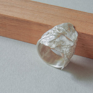Leaf ring in white silver.  Wide ring with the shape of a leaf.