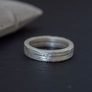 Set of two thins square silver wedding ring with tree bark texture