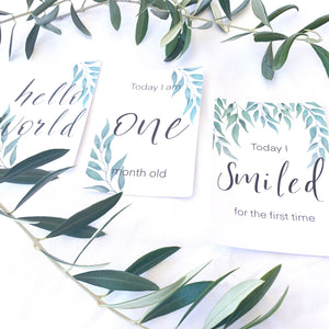 three leaf baby milestone cards with olive leaves