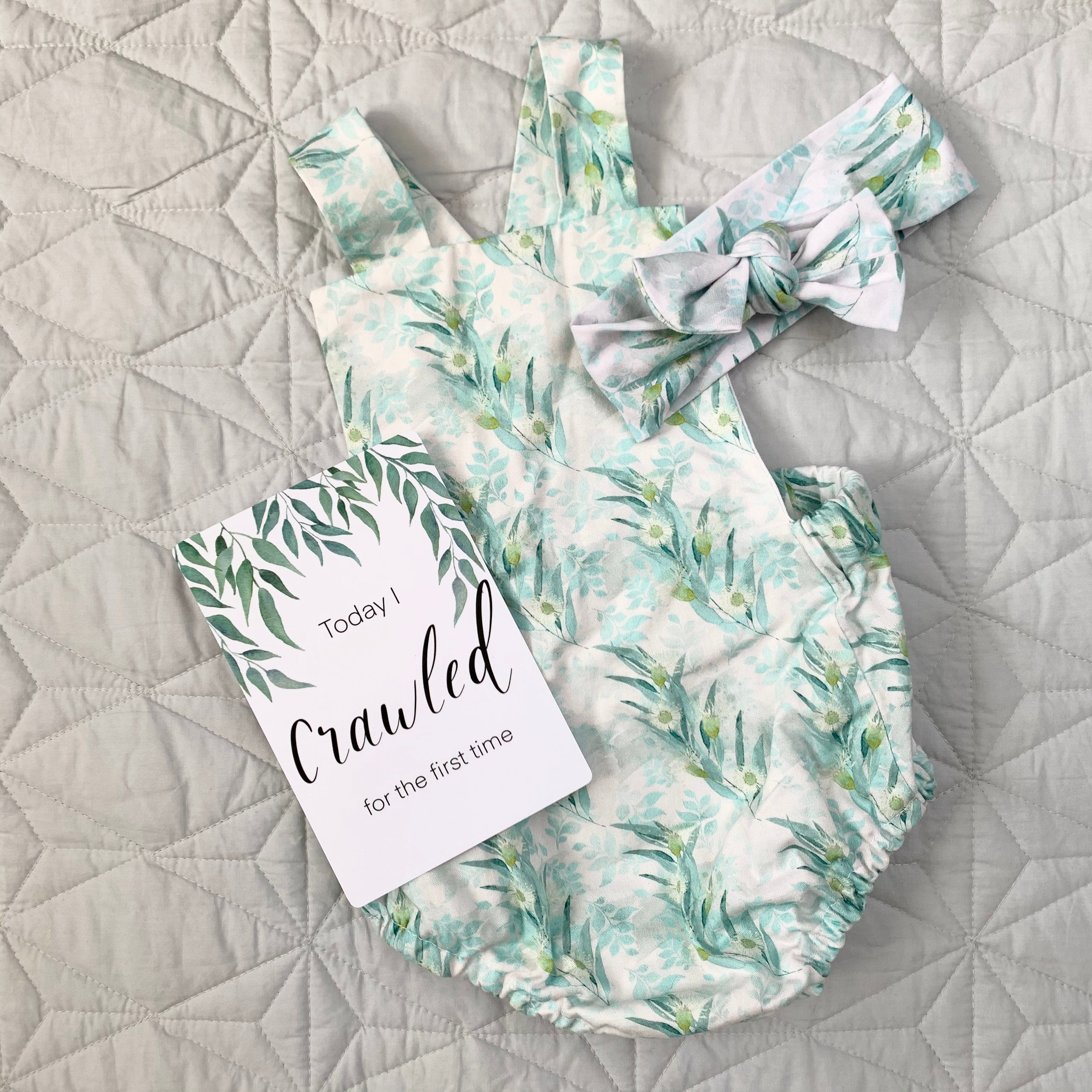 leaf baby milestone card with girls leaf baby romper and matching bow headband