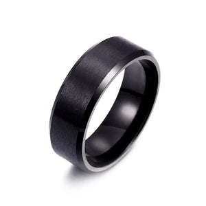 Titanium alloy ring in black, with brushed surface and angled band corners.