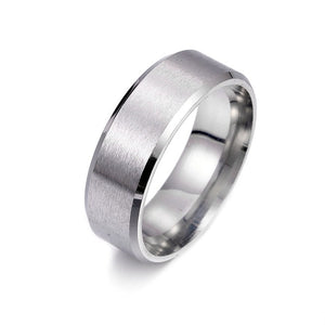 Titanium alloy ring in silver, with brushed surface and angled band corners.