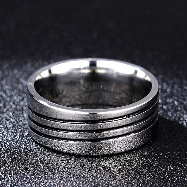 Titanium alloy ring diagonal bands in black (unisex) 8mm wide.