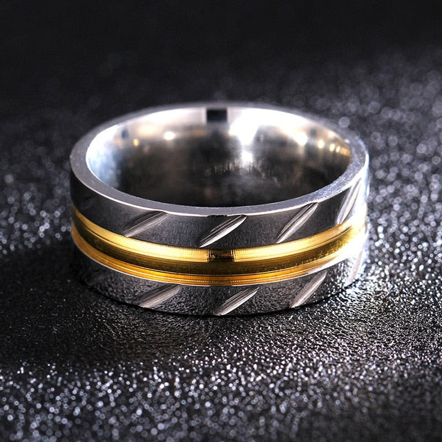Titanium alloy ring with goldlook band and angled profile notches (unisex) 8mm wide.