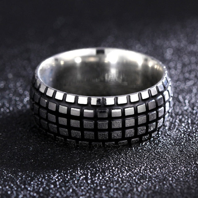 Titanium alloy ring with round surface and square studded pattern (unisex) 8mm wide.
