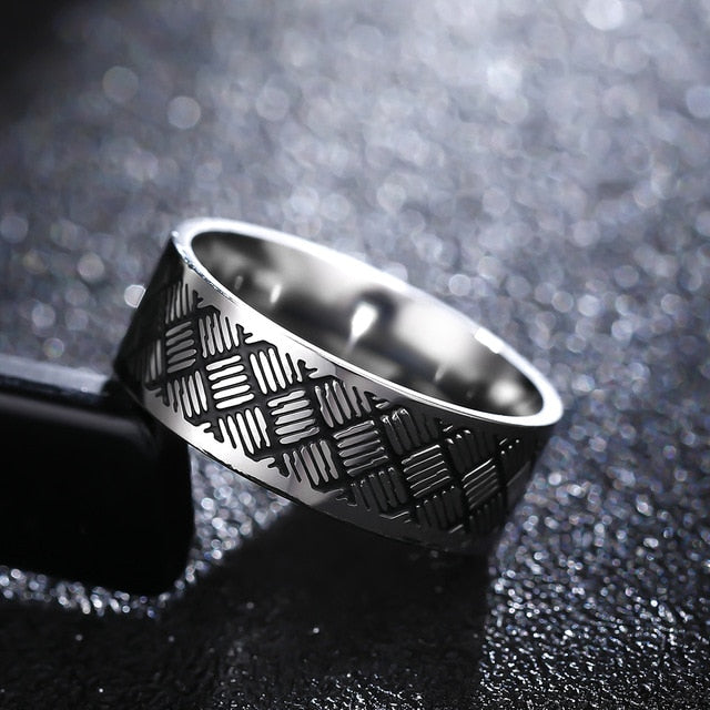 Titanium alloy ring with basket weave pattern (unisex) 8mm wide.