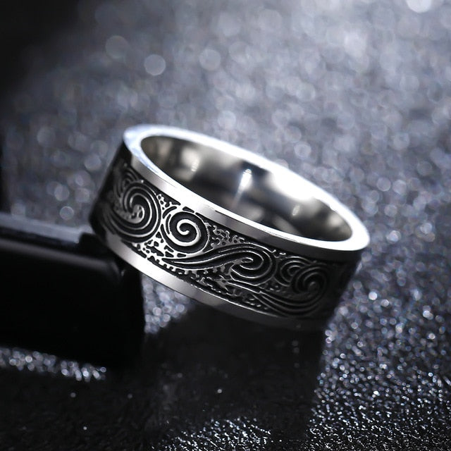 Titanium alloy ring with Maori wave pattern (unisex) 8mm wide.