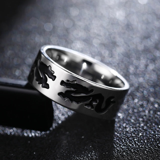 Titanium alloy ring with Chinese dragon pattern (unisex) 8mm wide.