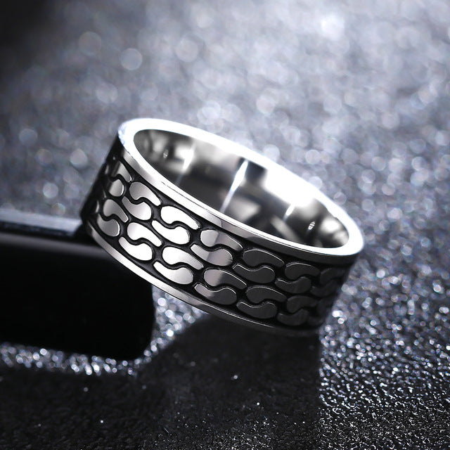 Titanium alloy ring with medieval armour decoration (unisex) 8mm wide.