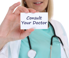 A lady doctor showing card text - consult your doctor