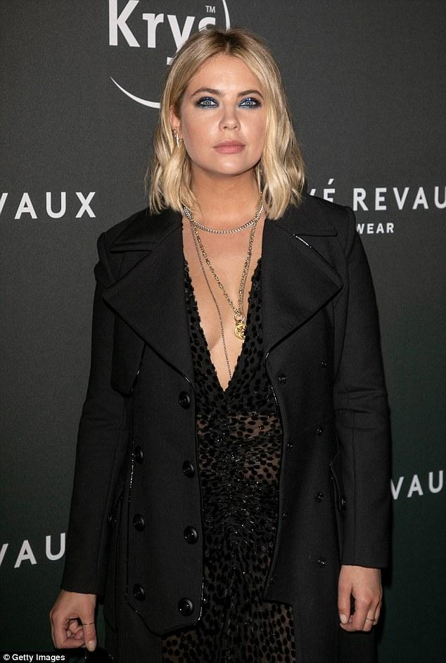 Ashley Benson looks chic in a plunging sheer dress and booties at Prive Revaux PFW party
