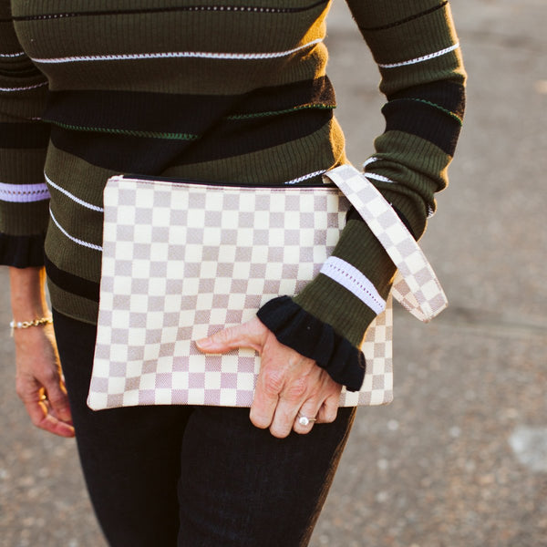 checkered cream clutch
