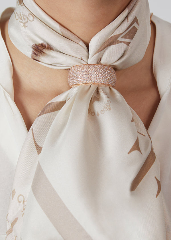 Revolution scarf ring in 18 karat rose gold and diamonds. this scarf ring is crafted in italy from 18 karat rose gold and white round cut diamonds, it features a full diamond pavè design. here worn with beige silk scarf