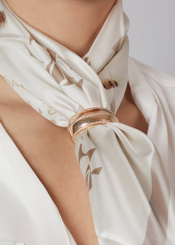 Tendance scarf ring in 18 karat rose gold and diamonds. this scarf ring is crafted in italy from 18 karat rose gold and white round cut diamonds. here worn with beige silk scarf