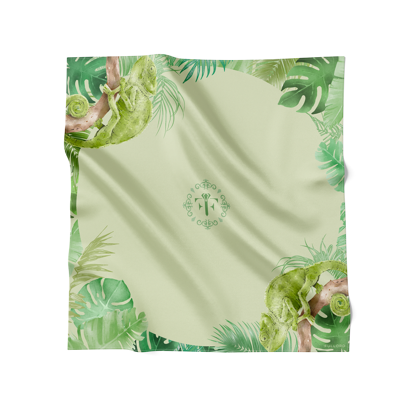 Green wool and silk scarf with bright green cameheleons and jungle leaves. This green scarf is made in France and measures 140 x 140 cm