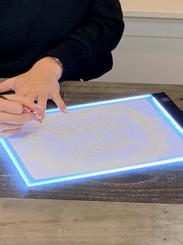 Trace your design on regular copy paper using a light box