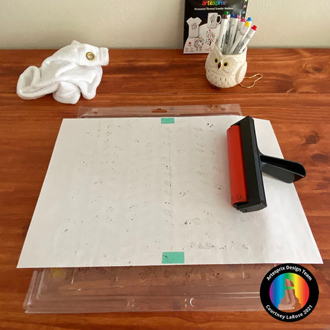 Place sheet of paper on colored Gel Press Plate