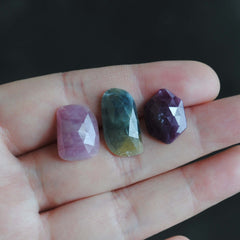 Faceted sapphire and ruby cabochons
