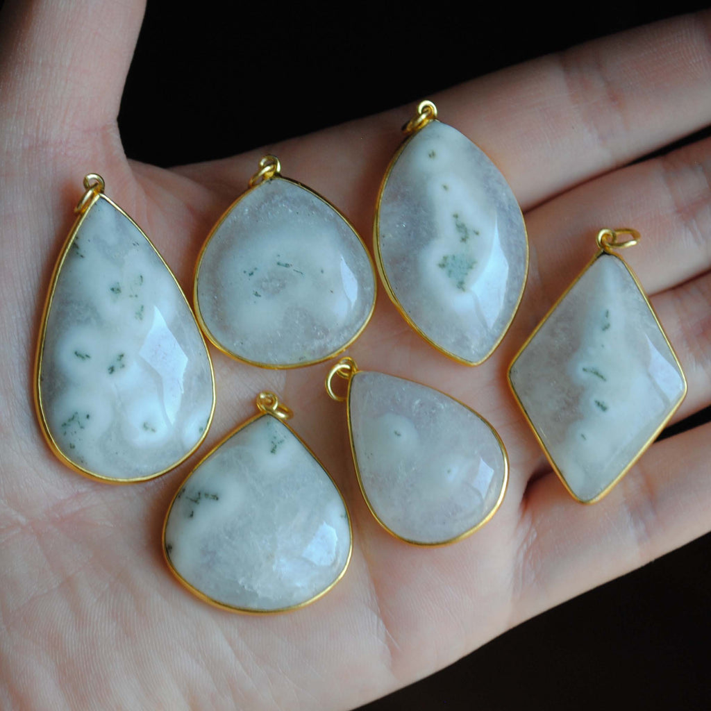 Solar Quartz gold plated pendants