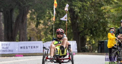 Tommy Q riding a recumbent bike in support of Stroke Foundation Australia