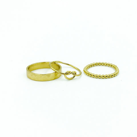 YELLOW GOLD STACK RING SINGLE KNOT SET