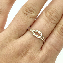 DELICATE DOUBLE KNOT RING