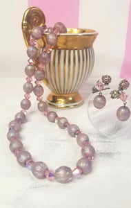 True vintage!  Soft pink iridescent and crystal beads, with matching clip on earrings.