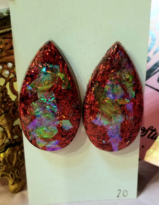 Large teardrop shaped red and green iridescent resin earrings. Stainless steel posts.