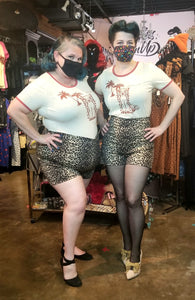Who doesn't love tiki and cats? Fun cream colored ringer tee with brown collar and print from Voodoo Vixen.