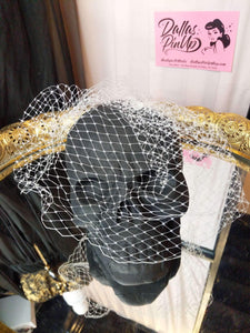 Birdcage veil, made of 8 inch Russian netting. Attaches with secure pop comb clip.  Ivory.