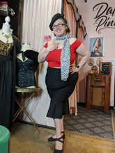 Load image into Gallery viewer, Black wiggle skirt with ruffled flounce at knees. High waist with back zipper. Soft stretchy fabric. Looks great on everybody!