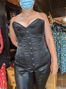 Black satin overbust corset with steel boning and metal front busk clasp. Tight laces in back.