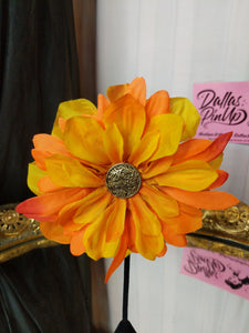 Orange fall colored hair flower with clip and gold accent button