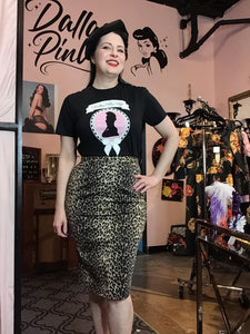High waisted pencil skirt made with stories sturdy leopard stretch denim. Hem comes to just below knee. Created by local designer, Billie Jo Retro.
